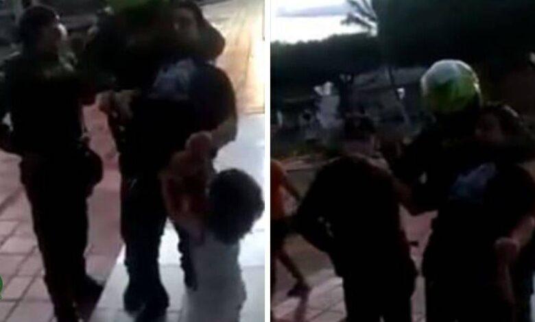 Policía inmoviliza a padre que paseaba con su hijo 1